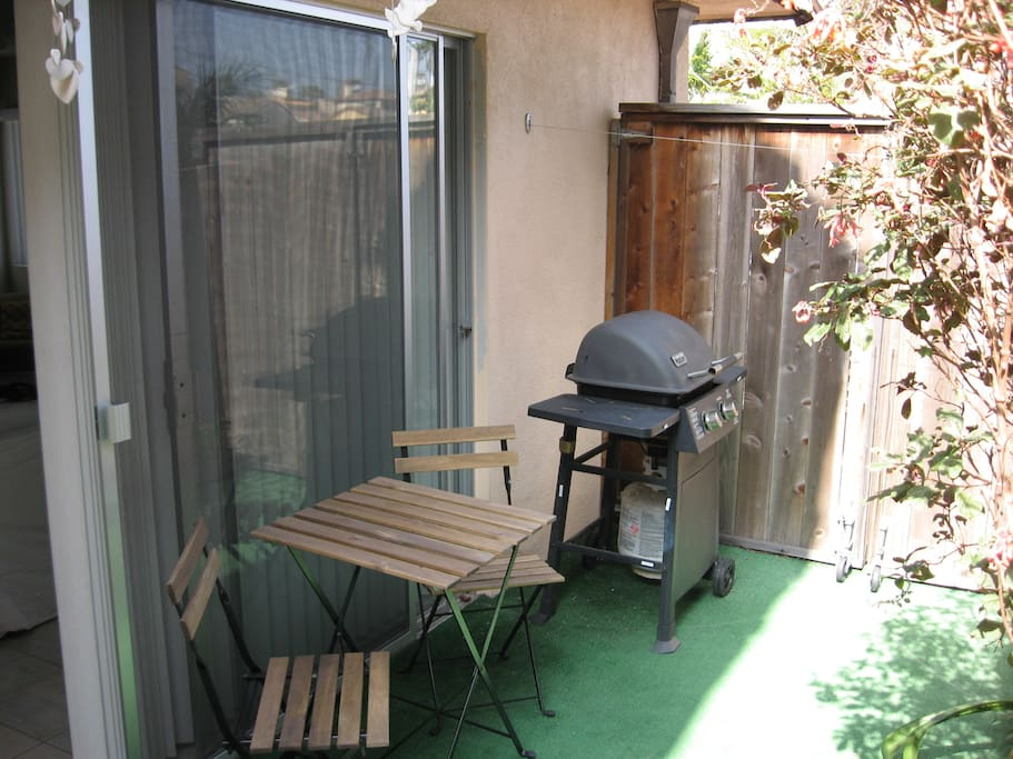 Patio area with grill.  We do supply a basic set of grilling tools.