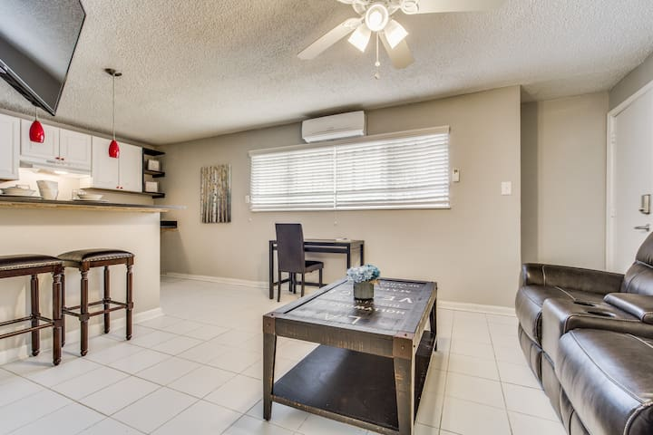 Pull up a chair! Feel the comfort of your own home! This room is complete with a convenient work space, a ductless AC/Heating unit and a modern ceiling fan to accommodate you in any weather. Powered by a remote.