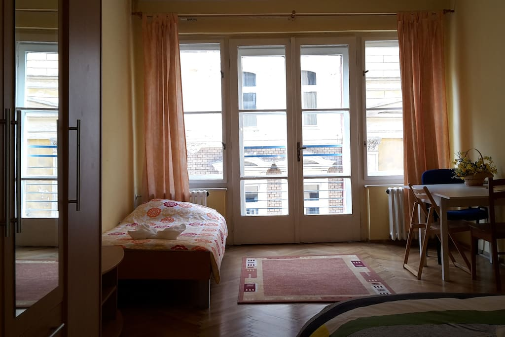The bedroom contains a double  bed, single bed, wardrobe, table with chairs and night tables.