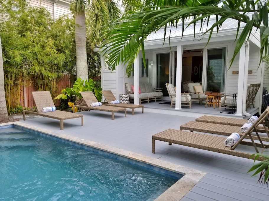 Outdoor area comes with plenty of poolside loungers