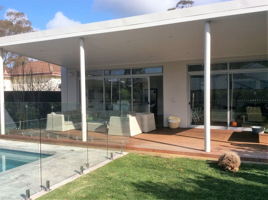 Outdoor decking overlooking pool and garden