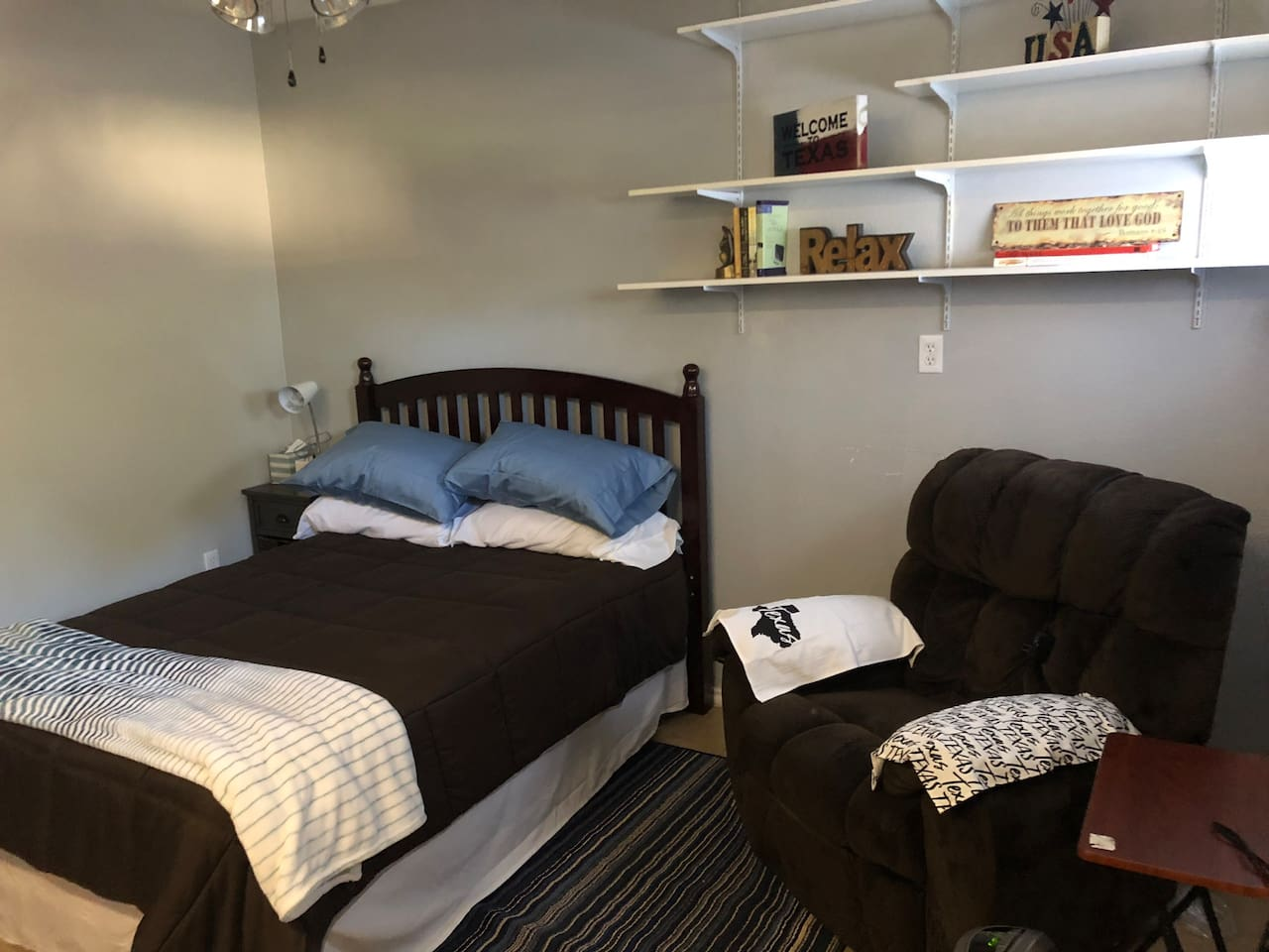 Queen size bed, recliner, nightstand, lamp, clock