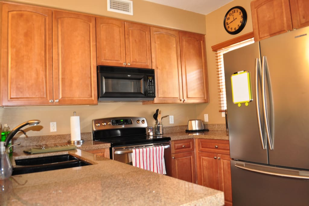 Kitchen with new appliances.  All cookware and utensils provided.
