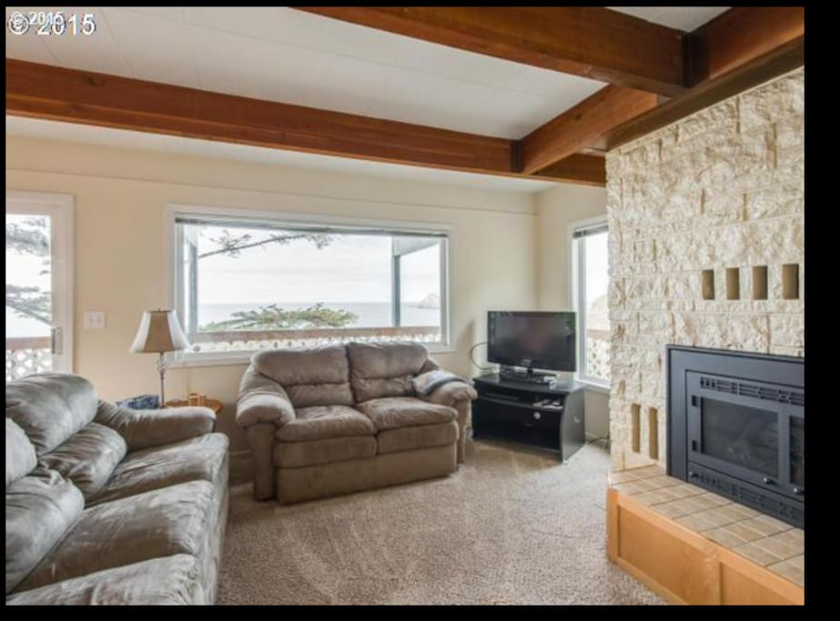 living room, sofa bed, propane fireplace, sliding glass door to deck