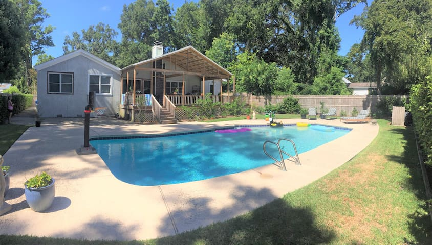 Huge pool and shaded deck are the perfect back yard for a family vacation