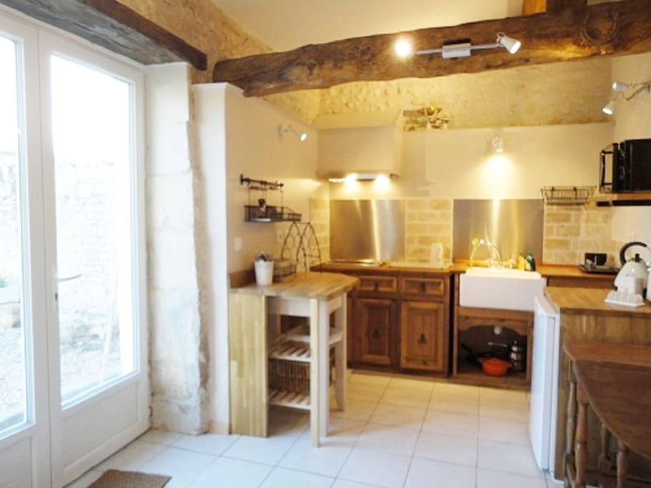 Alcove kitchenette with hob, fridge, microwave, kettle, toaster  and slow cooker