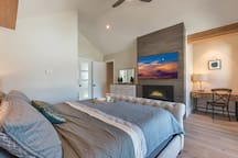 Enjoy an elegant king-size bed and large TV in the master bedroom.