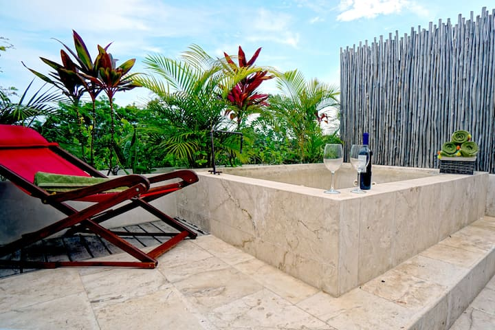 Relax in your own private roof top jacuzzi and enjoy the soothing sights and sounds of the jungle