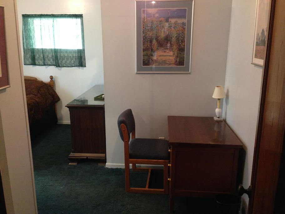 Entrance to room with Desk and lamp