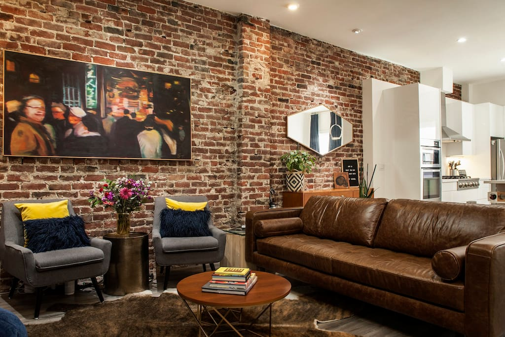 The apt has all brand new furnishings and mid-century modern decor.  The faux cow-hide rug is a guest favorite!