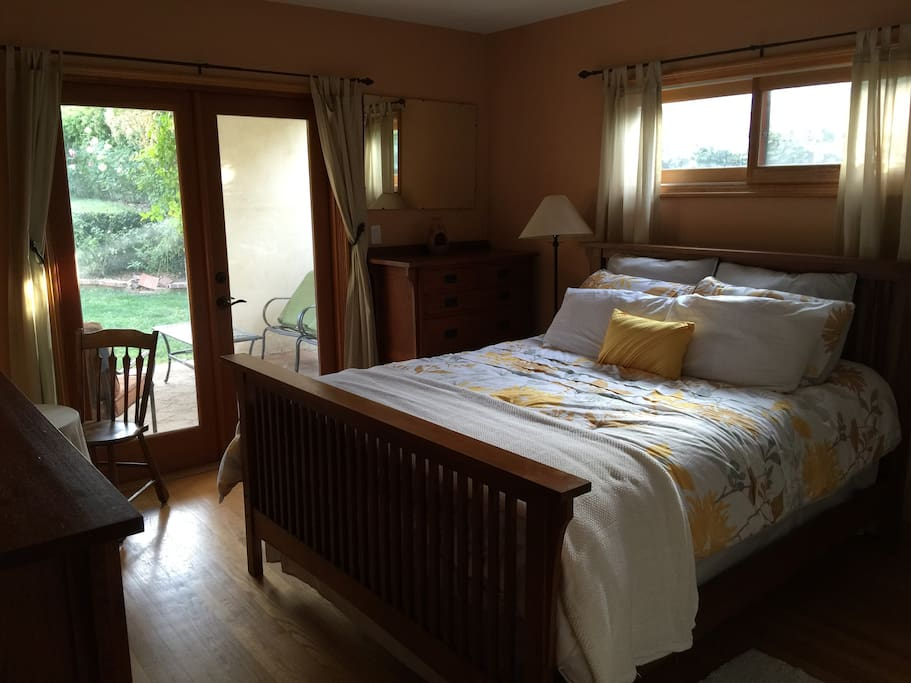 1st of two bedrooms, opens to the garden. Queen bed, sleeps 2.