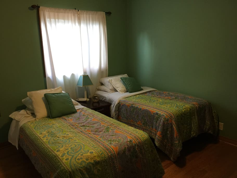 Very private room with 2 Twin Beds (sleeps 2) and a desk and closet.