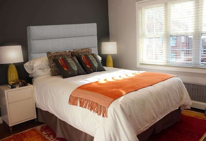 Second bedroom with new queen size bed, area rug, plentiful closet space and ceiling fan.