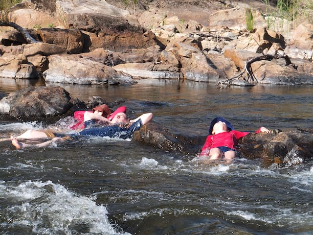 Enjoying lying in the rapids