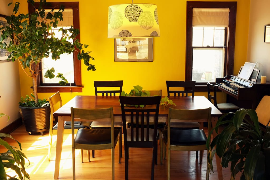 Dining room, including table made from reclaimed redwood from Omaha's Falstaff brewery.