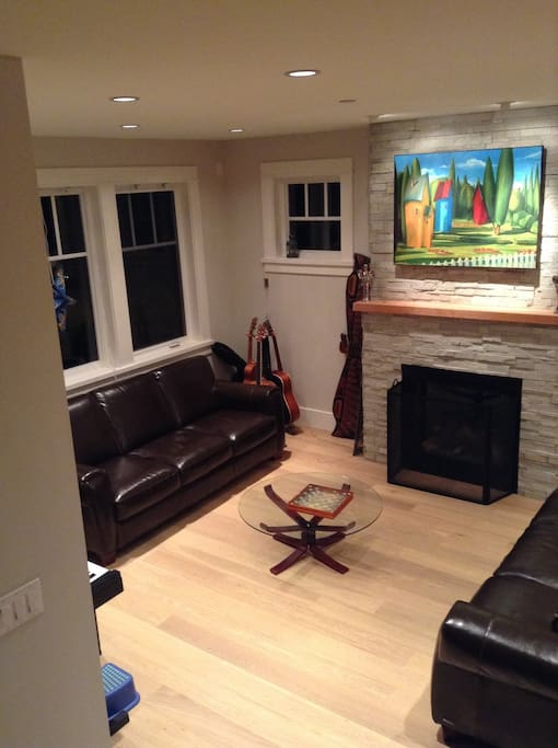 Living room with electric piano and gas fireplace
