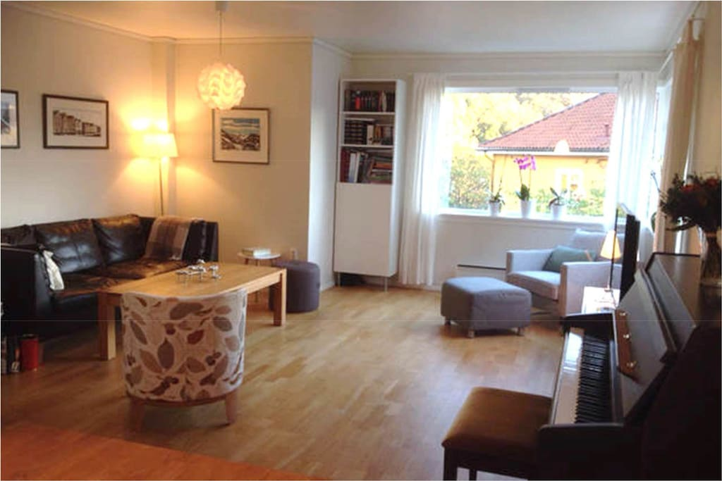 Cosy and spacious living room, as seen from the kitchen