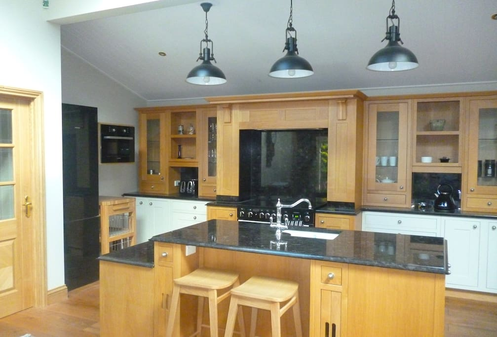 Designer oak and granite Kitchen with quality appliances.