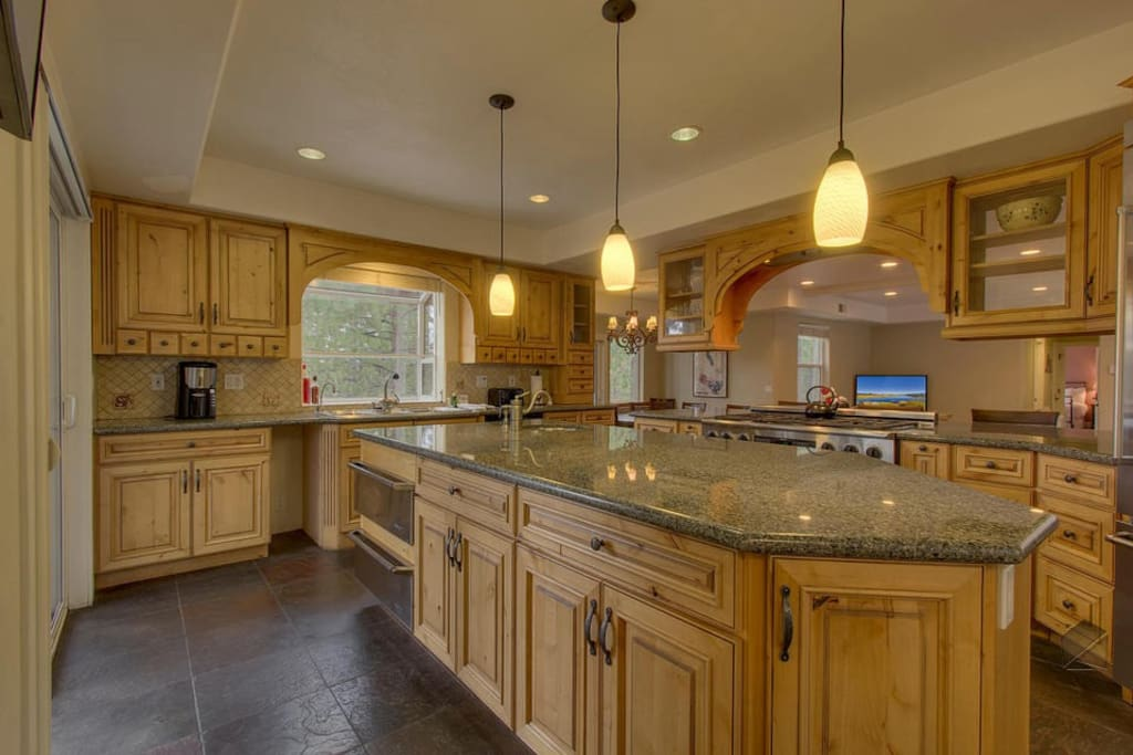 The kitchen has plenty of counter space for multiple chefs when cooking for a large group
