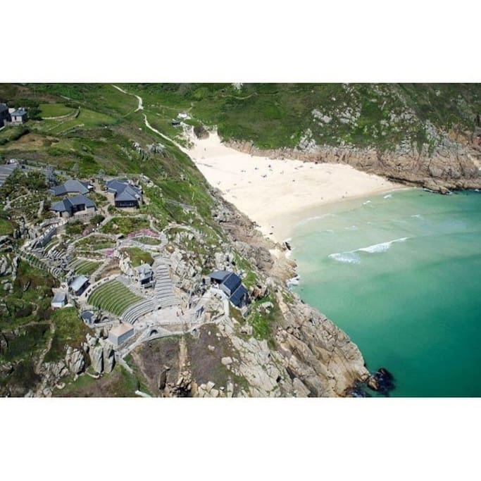 Porthcurno beach with The Minack Theatre nestled into the cliff.