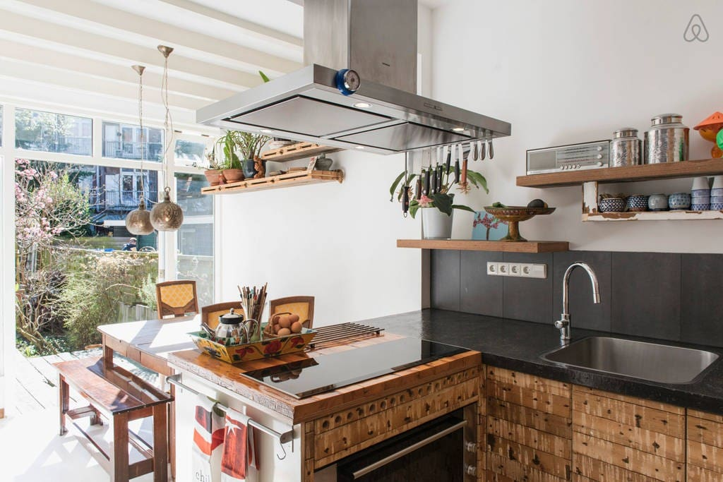 modern well-equipped kitchen facing terrace