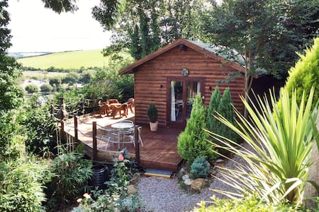 A Beautiful Wooden Chalet, set down many steps in extensive gardens with wooden decking surrounding it. This cabin is more suited to a couple or small family.  Far reaching views over Newquay boating lake and beyond add to the tranquil nature of this
