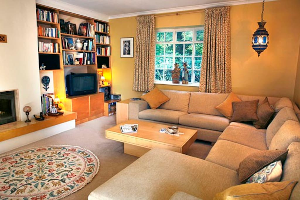Large Living room with comfortable Sofas and TV .