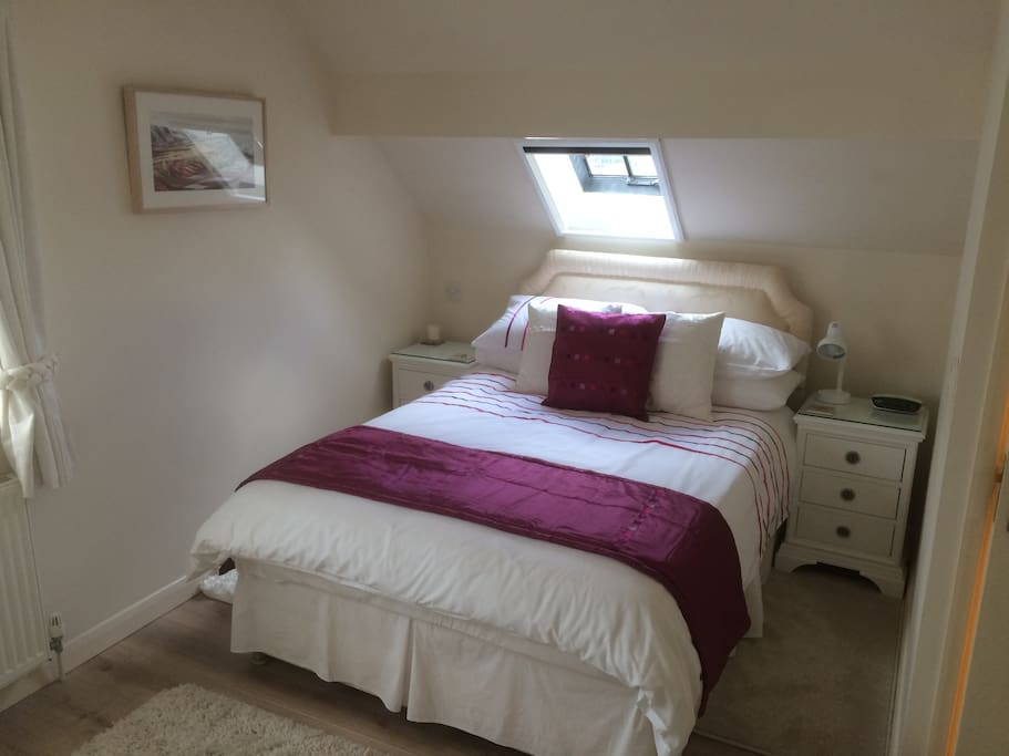 Luxurious double bed in the Riley Suite