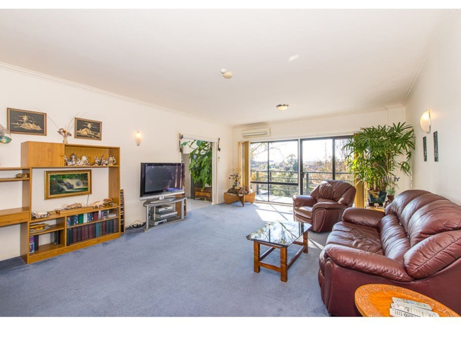 Large lounge room with exit to a balcony