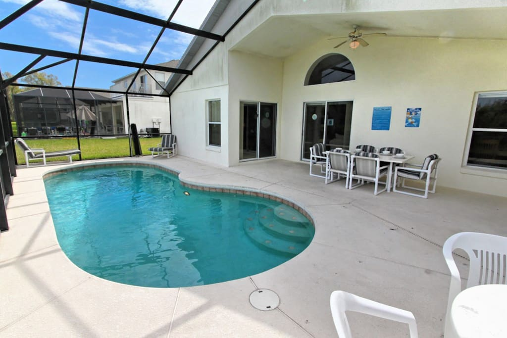 This sparkling clear, private pool is a perfect oasis in the sunshine during your vacation stay at this wonderful pool home. Sit and enjoy the view out to the lake as you bask under the warm Florida sunshine.