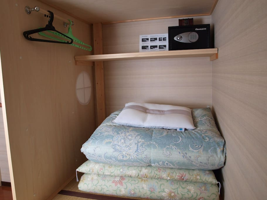 A share bed with security box and clothe hungers.