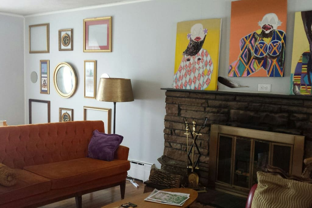 original art throughout home, fireplace used when host is home (only) comfy retro furniture, wood floors thruout