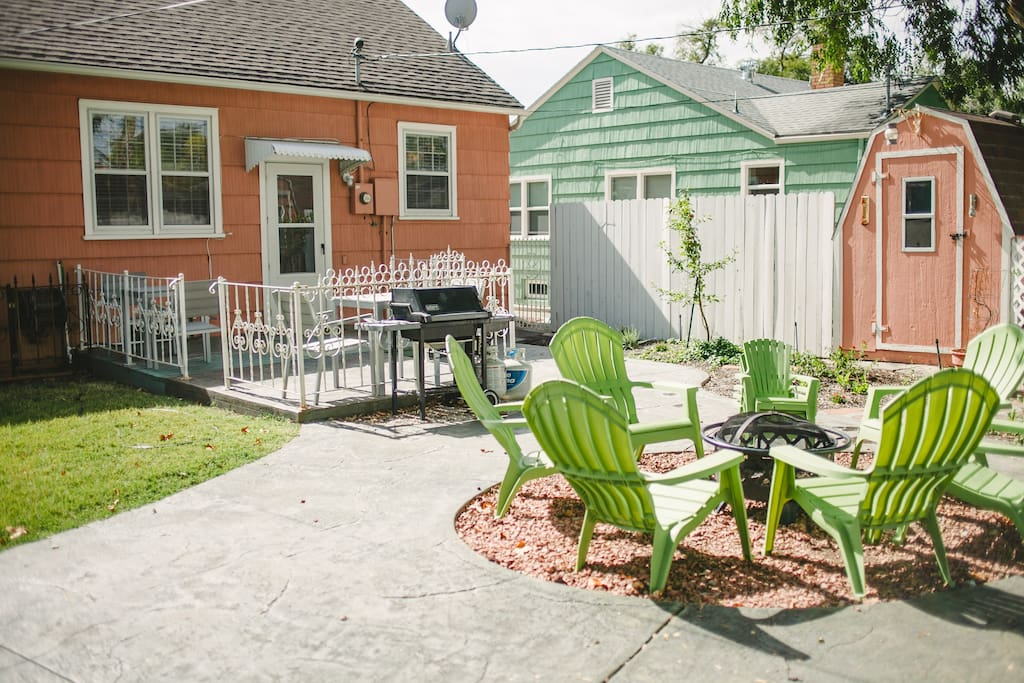 Private back yard includes plenty of seating, grill and fire pit
