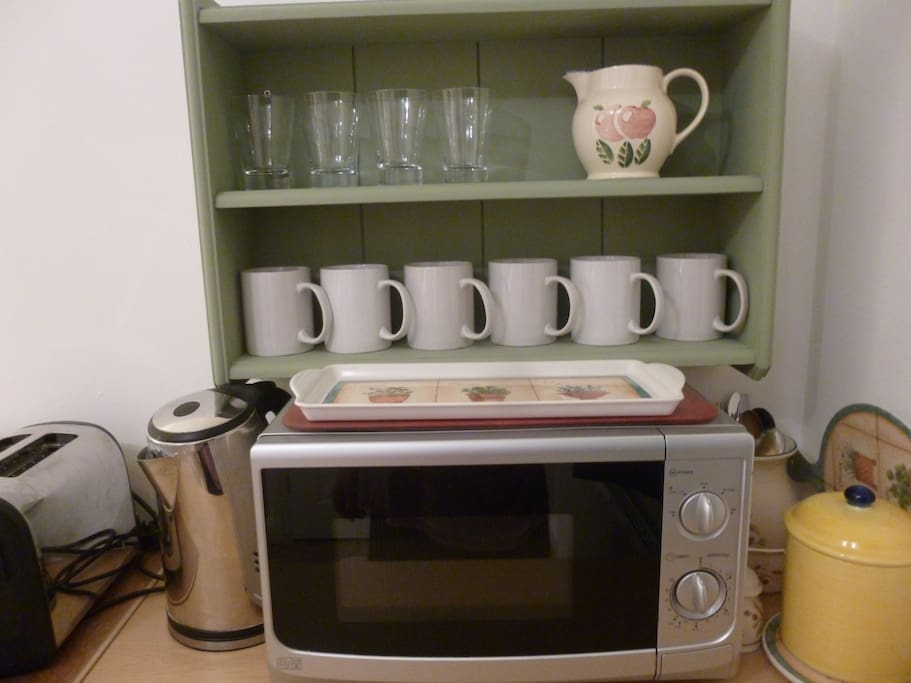Microwave, kettle, toaster, crockery and cutlery. New fridge.
