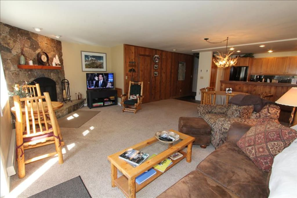 Living/dining with sofa bed and gas fireplace