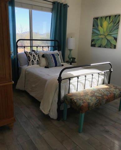 Beautiful bedroom & bath w/mountain views and pool