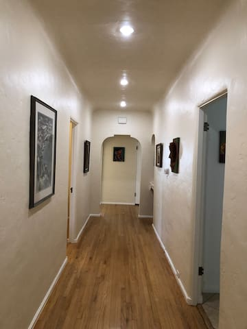 Hallway. House has three bedrooms and two restrooms
