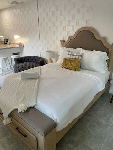 Comfortable queen bed awaits you after a long day