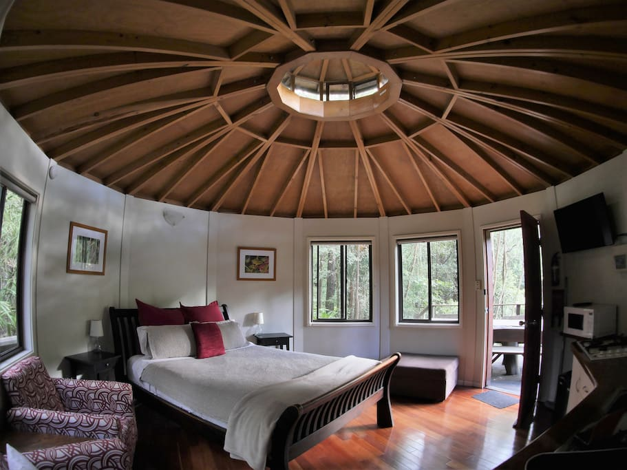 Vaulted timber ceiling and queen size bed