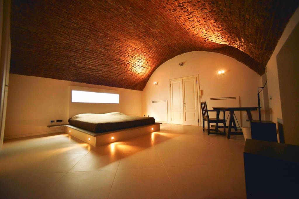 King size bedroom with 16th century red brick vaulted ceiling