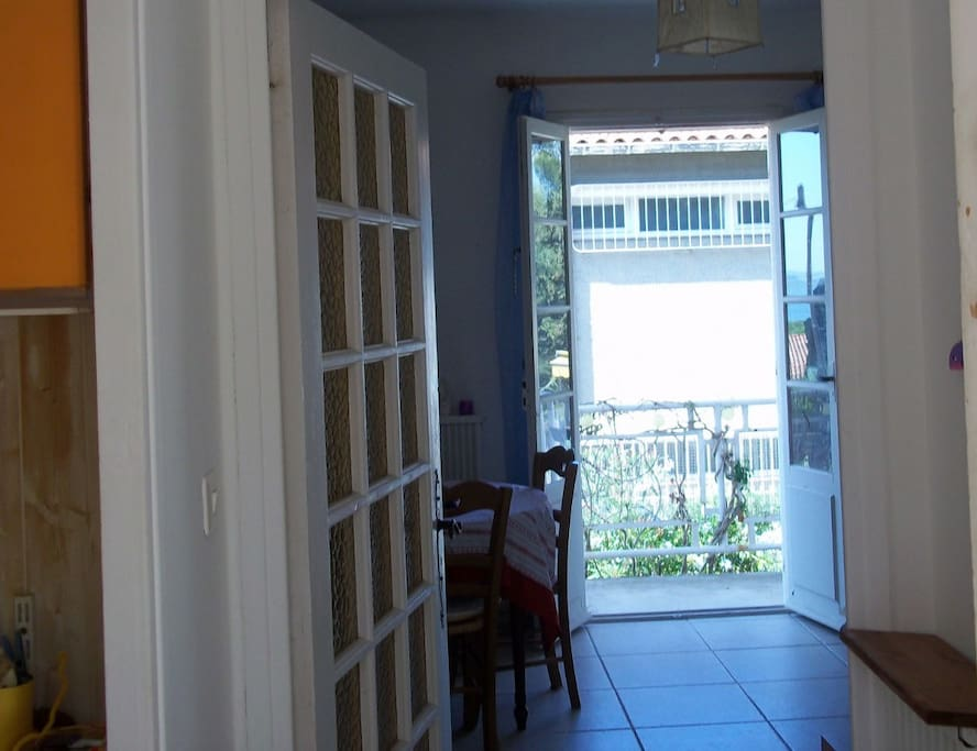 Entrance of the apartment and view over balcony