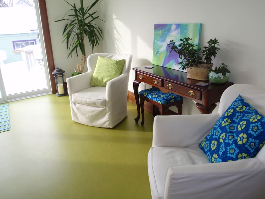 Sunny room that opens to back yard.  Perfect for relaxing with a coffee or doing yoga.
