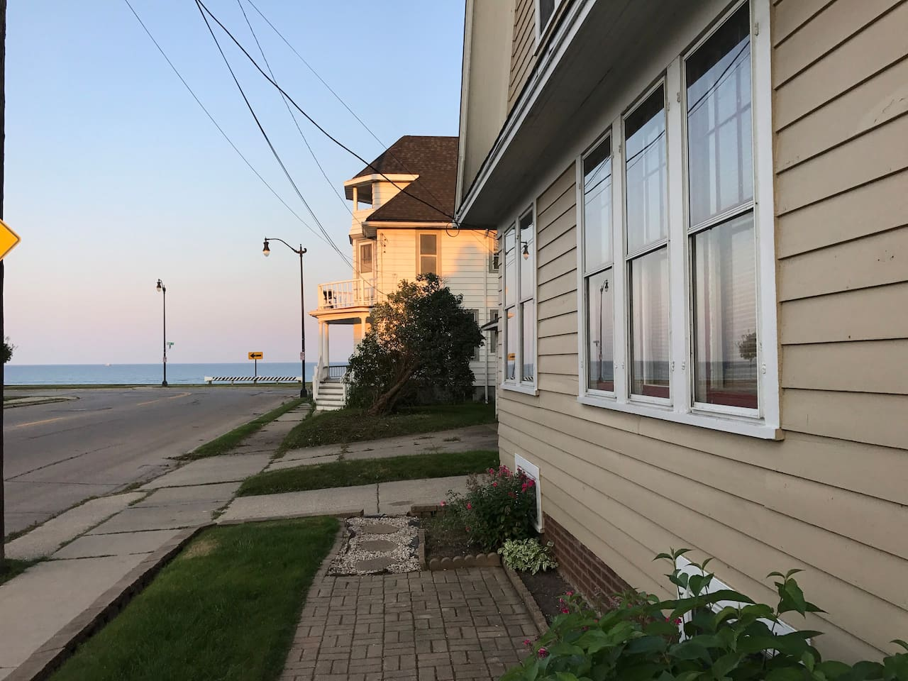 Enjoy your coffee in the morning while watching the sun rise over Lake Michigan.