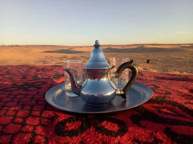 Camp and Camel trek in desert sahara peace