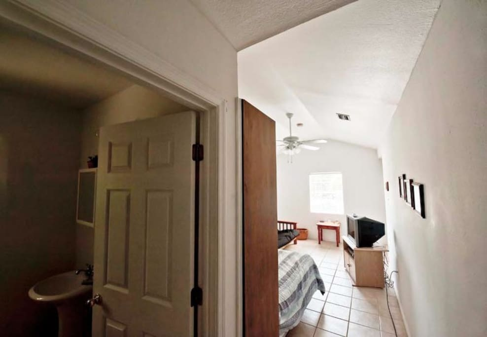A small room for 2 people, No futon included. Has TV, mini-fridge and bathroom - A/C