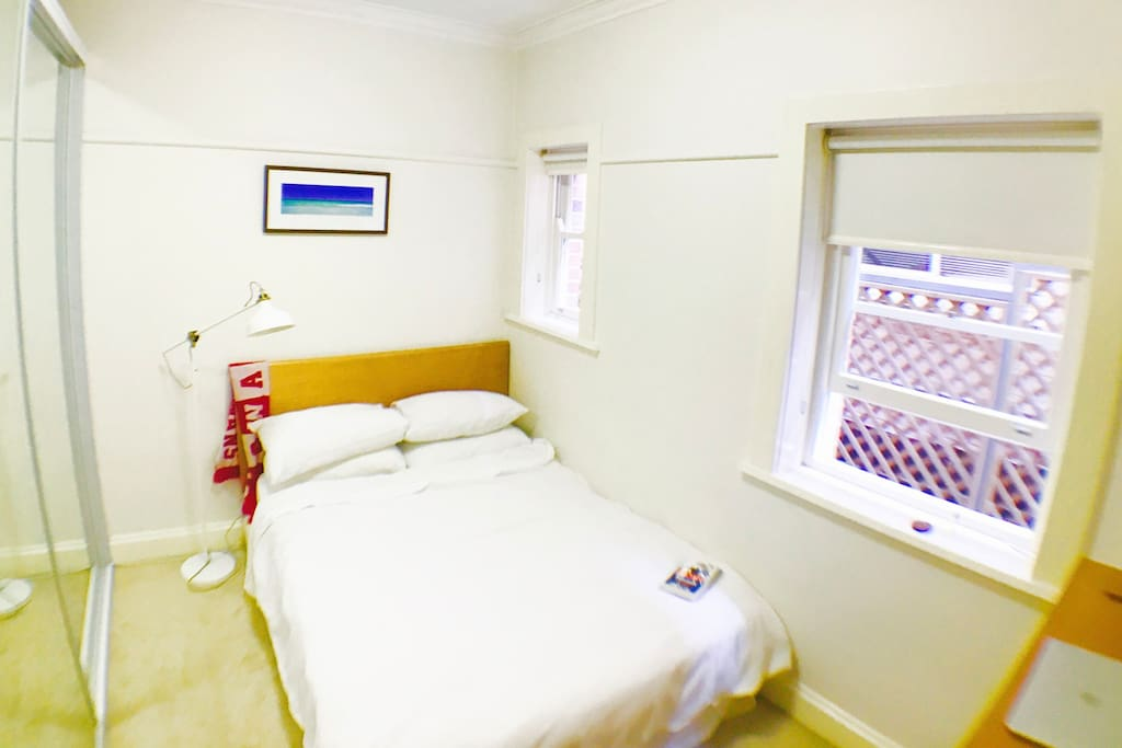 Sweet double room with clean white sheets, natural light and a heater for colder nights.