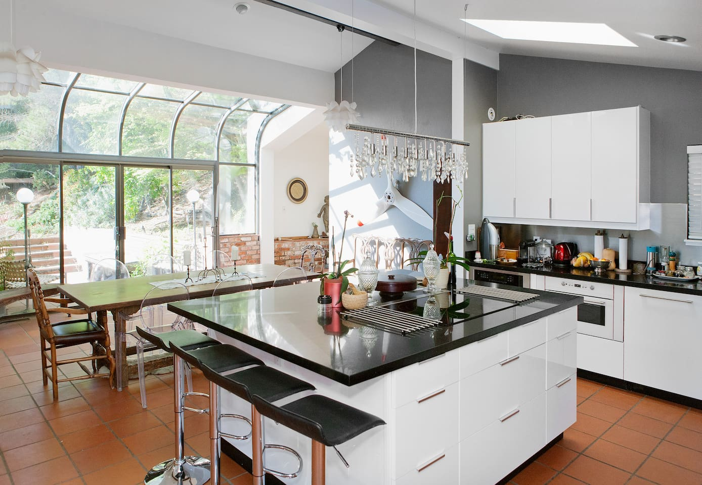 Huge modern kitchen is where everyone always end up congregating!