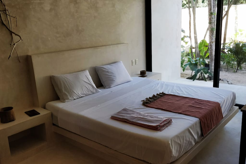 Room B: King size bed with access to garden and pool.