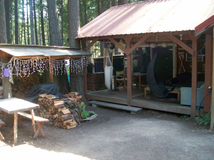 Large deck with heaters, sofa and table to eat at. Also a BBQ shed