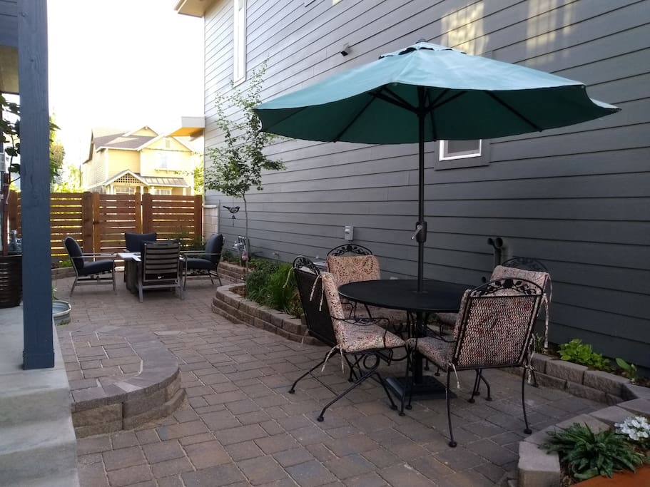 Patio area with eating space and gas firepit